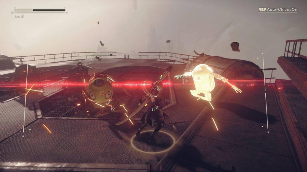 2B fighting robot enemy on metal platform.
