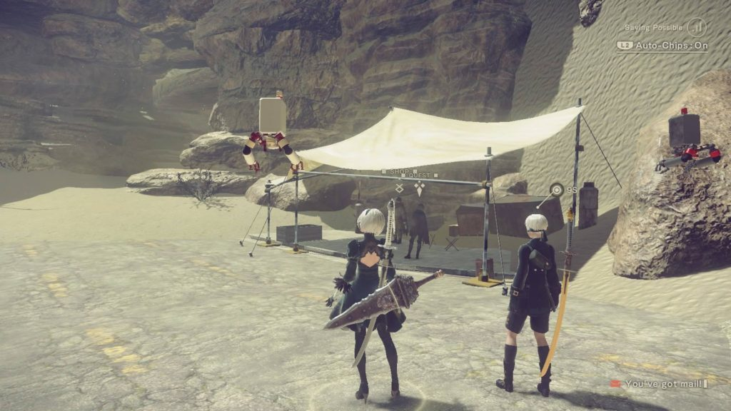 2B and 9S in the desert near a vendor standing under a tent.