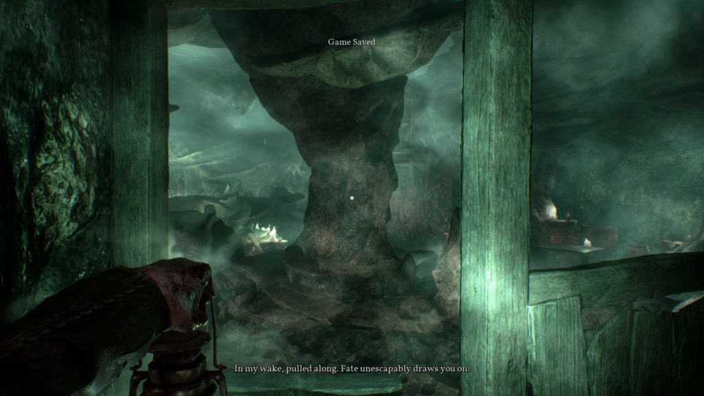 Inside a foggy cave with illegible subtitles showing.