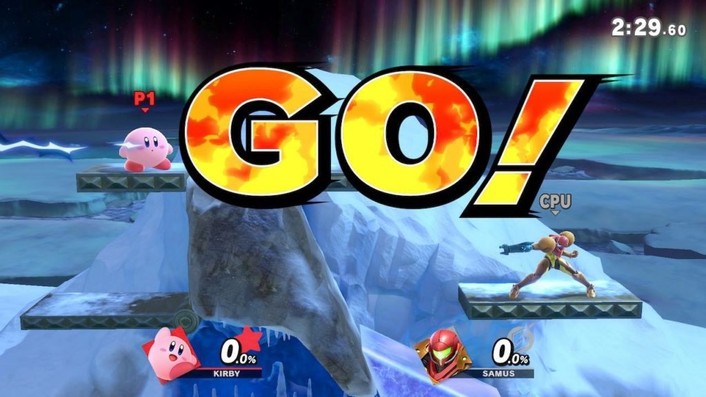 "Kirby and Samus in a Super Smash Bros. Ultimate match. Fight stage is an iceberg with big bits of ice in the background. Announcer call-out ""GO!"" is displayed on the screen."