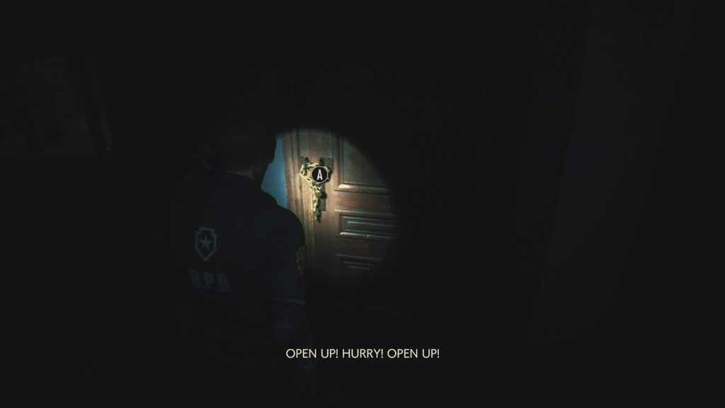 Player character approaching a door with a small area illuminated by a flashlight.