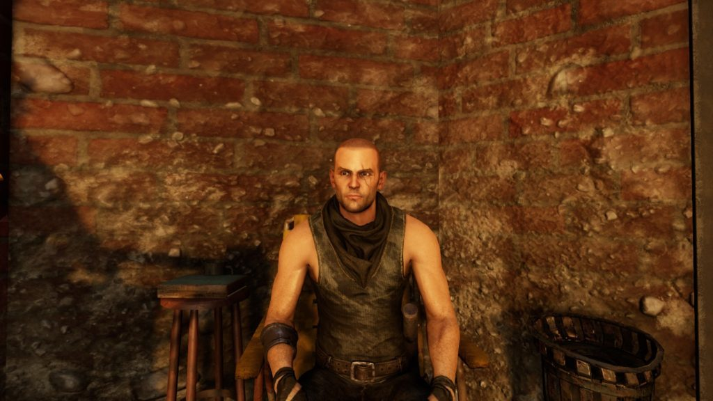Player character sitting in a chair inside red brick room.
