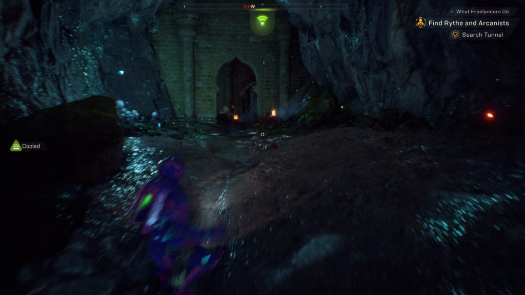 Javelin running into a dark cave, enemies indicated by red dots.