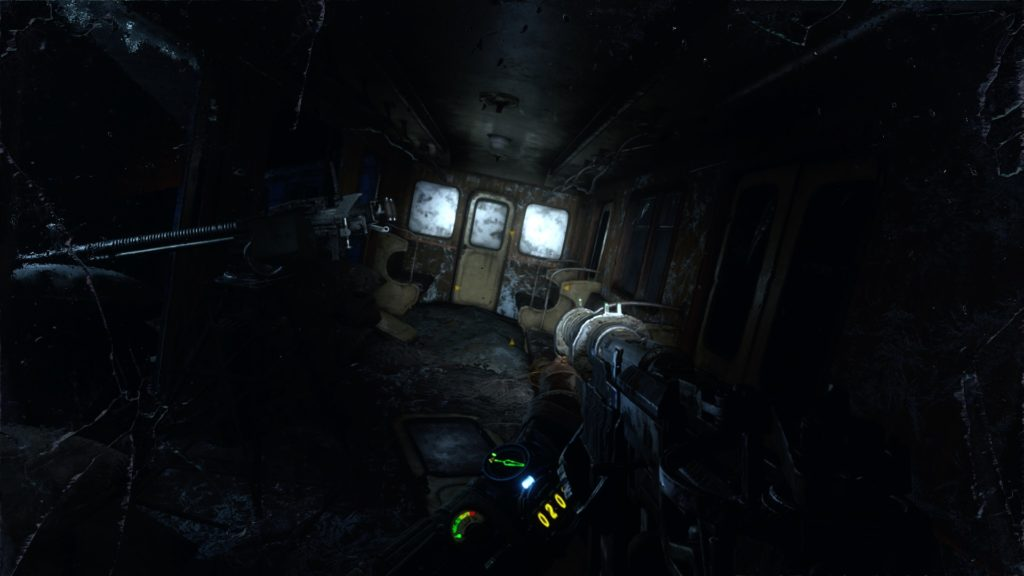 Player walking through dark destroyed train car