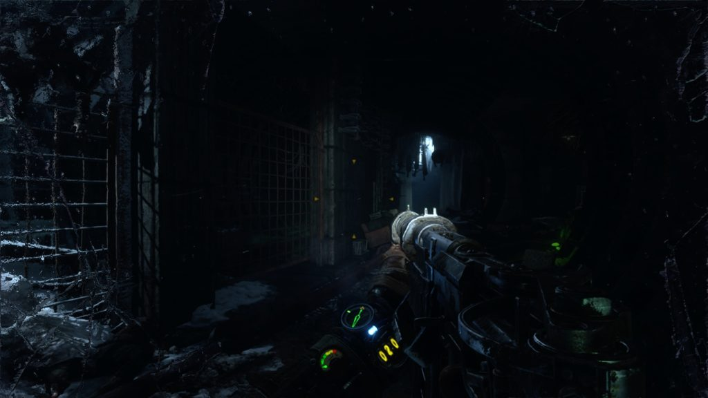 Player walking through dark tunnels carrying a gun