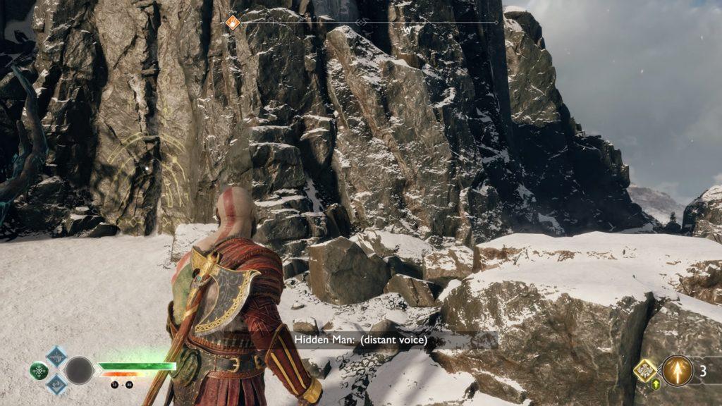 Kratos walking toward a mountain.