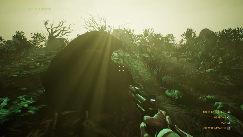 On a green, lush planet, sun glare on screen, ship captain holding a handgun.