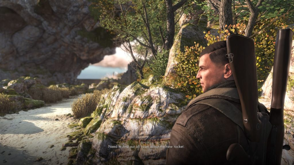 Player character standing on beach near rock arch. Illegible subtitles displayed.