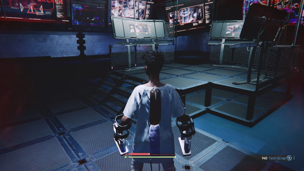 Player character standing in a room full of TVs on but no subtitles.